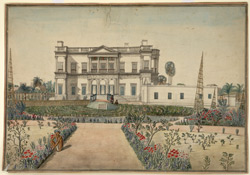 A classical European style house with a garden in the foreground.